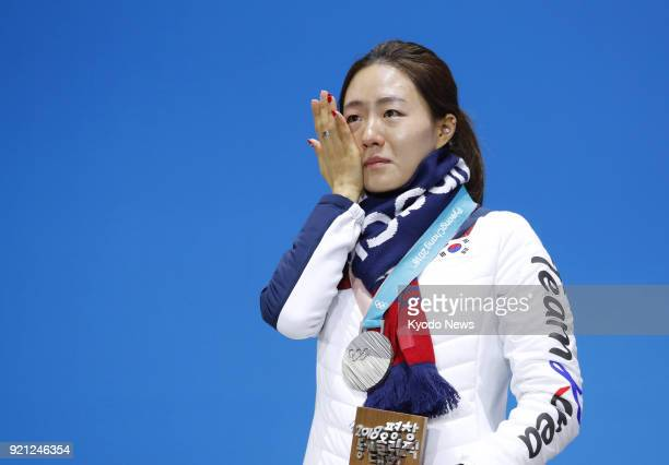 Women's 500meter speed skating silver medalist Lee Sang Hwa of South Korea cries at the medal ceremony at the Pyeongchang Winter Olympics in South...