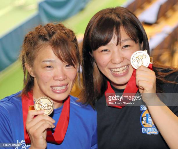 Women's 57kg gold medalist Risako Kawai and Women's 62kg gold medalist and her sister Yukako Kawai pose for photographs on day four of the All Japan...