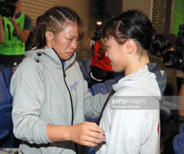 Women's 57kg gold medalist Risako Kawai is congratulated by Eri Tosaka on day four of the All Japan Wrestling Invitational Championships at Komazawa...