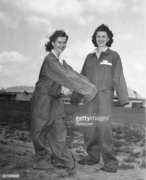 Women's Airforce Service Pilots Lenora Horton and Mildred Axton clown about in their oversized flight suits which they've dubbed 'ZootSuits' at...