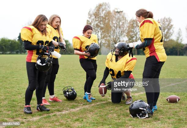 women's american football team getting ready - safety american football player stock pictures, royalty-free photos & images