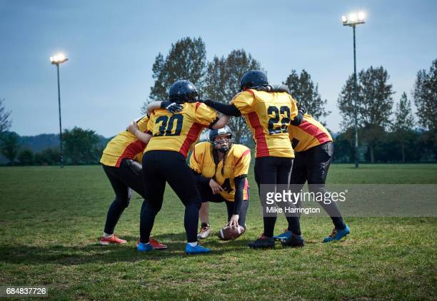 women's american football team huddling - safety american football player stock pictures, royalty-free photos & images