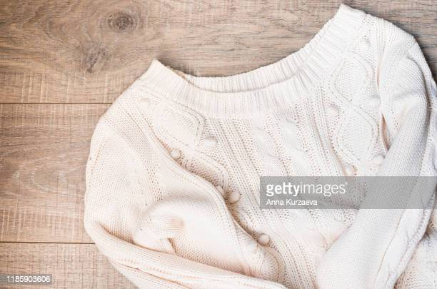 women's autumn, winter clothes - white knitted pullover oversize, top view. flat lay. - jumper stock pictures, royalty-free photos & images