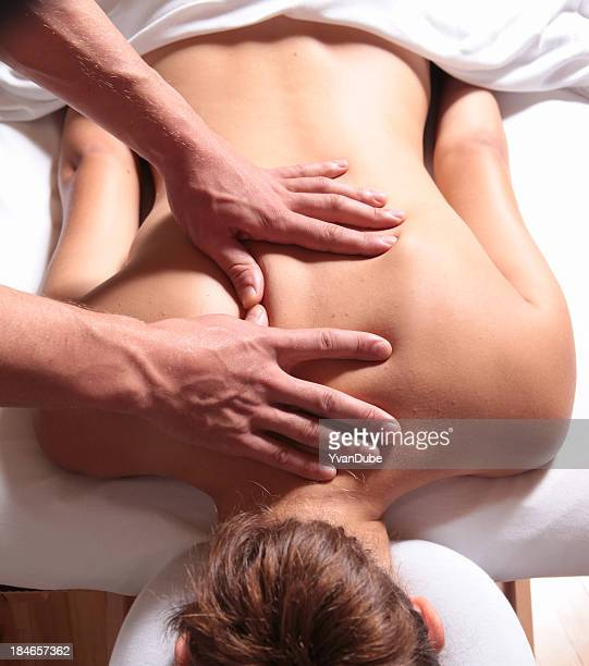 Women's back being massaged on a massage table