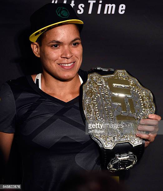 UFC women's bantamweight champion Amanda Nunes of Brazil speaks to the media during the UFC 200 postfight press conference at TMobile Arena on July 9...