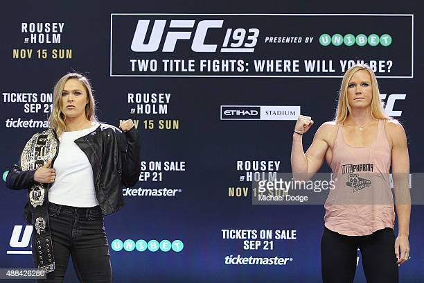 Women's Bantamweight Champion Ronda Rousey and her opponent Holly Holm pose during the UFC 193 media event at Etihad Stadium on September 16 2015 in...