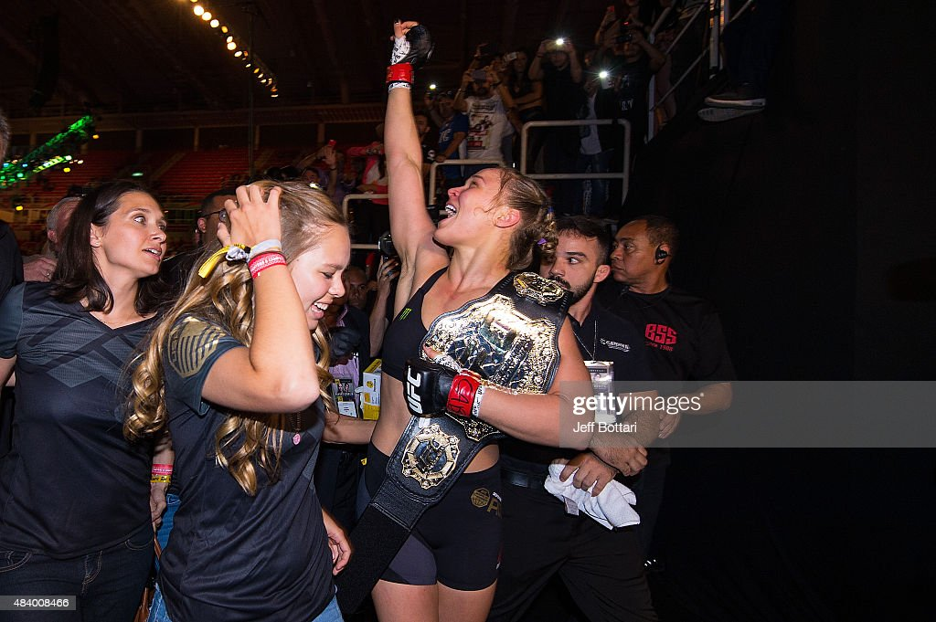 UFC women's bantamweight champion Ronda Rousey celebrates with her family and fans backstage after defeating Bethe Correira of Brazil by KO during the UFC 190 event inside HSBC Arena on August 1, 2015 in Rio de Janeiro, Brazil.