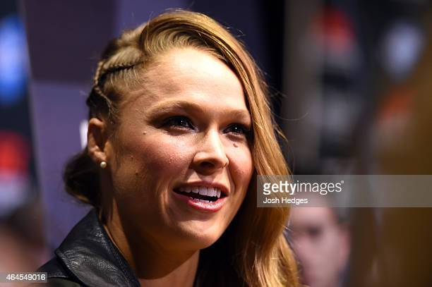 Women's bantamweight champion Ronda Rousey interacts with media during the UFC 184 Ultimate Media Day at Club Nokia on February 25, 2015 in Los...