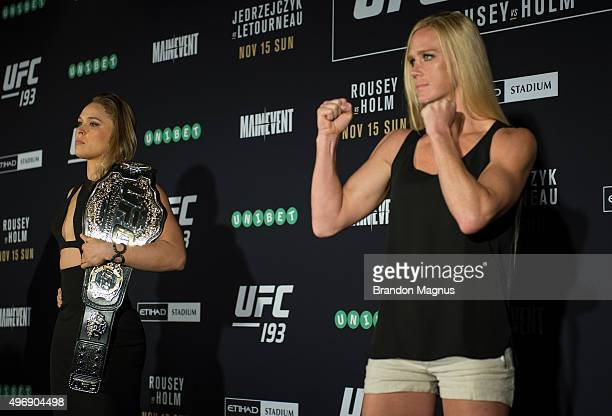 UFC women's bantamweight champion Ronda Rousey of the United States and Holly Holm of the United States pose for a photo during the UFC 193 Ultimate...