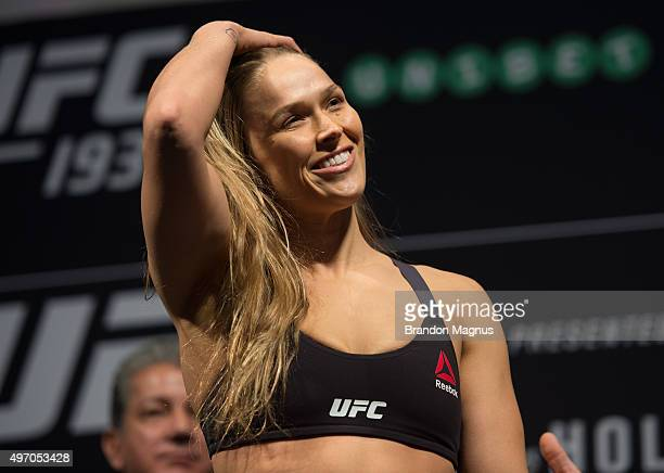 UFC women's bantamweight champion Ronda Rousey of the United States steps off the scale during the UFC 193 weighin at Etihad Stadium on November 14...
