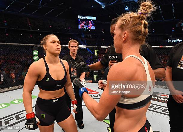 Women's bantamweight champion Ronda Rousey of the United States refuses to touch gloves with opponent Holly Holm of the United States before their...