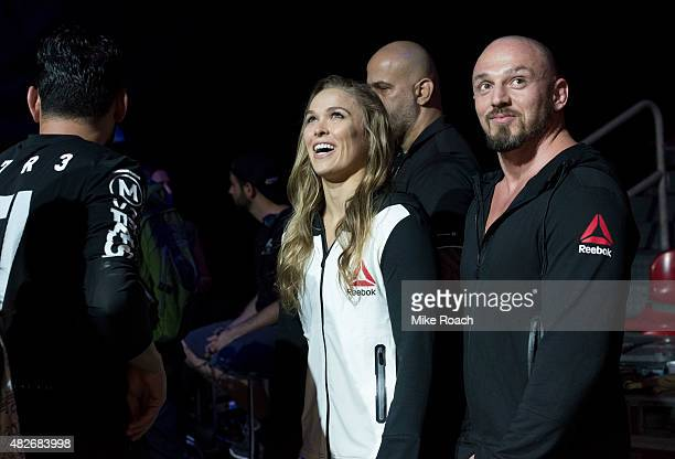 Women's bantamweight champion Ronda Rousey of the United States waits backstage with Mike Dolce during the UFC 190 weigh-in event at the HSBC Arena...