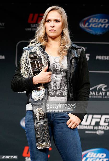 Women's bantamweight champion Ronda Rousey poses for photos during the UFC Ultimate Media Day at the Mandalay Bay Resort and Casino on July 3, 2014...