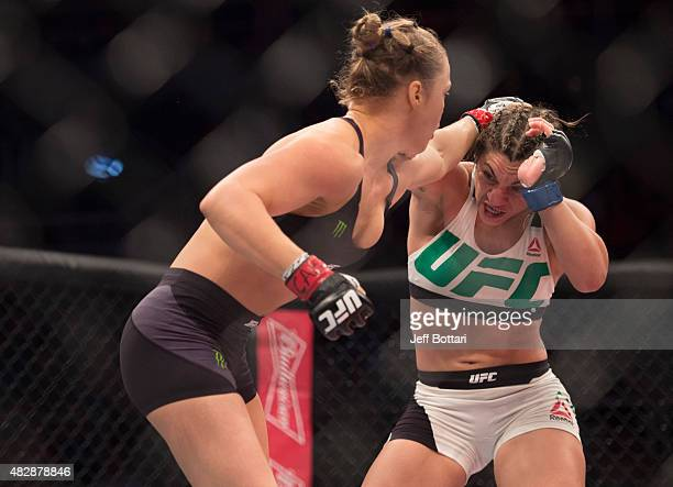 UFC women's bantamweight champion Ronda Rousey punches Bethe Correia of Brazil during the UFC 190 event inside HSBC Arena on August 1 2015 in Rio de...