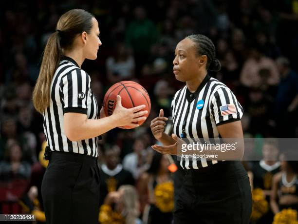 NCAA womens basketball officials discuss a call during the NCAA Division I Women's Championship third round basketball game between Arizona State Sun...