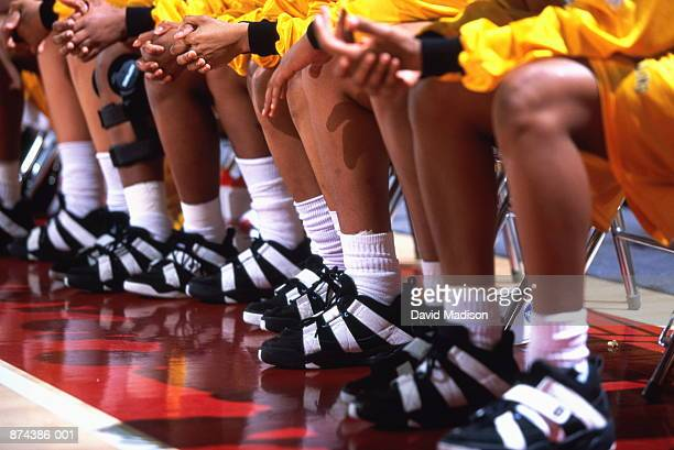 women's basketball team on bench, low angle view - only teenage girls stock pictures, royalty-free photos & images