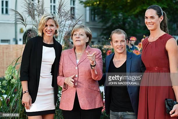 Women's beach volleyball gold medal winner at the Rio Olympic Games Laura Ludwig German chancellor Angela Merkel gymnastic gold medal winner Fabian...