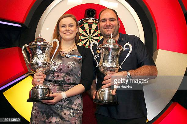 Women's Champion Anastasia Dobromyslova of Russia and Men's Champion Scott Waites of England show of their trophies during the final of the BDO...