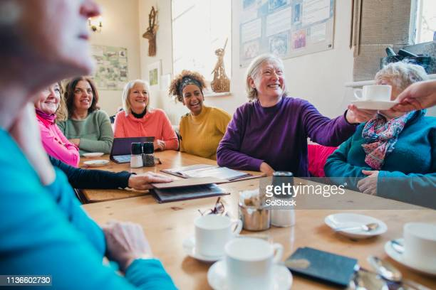 women's club at the cafe - organised group stock pictures, royalty-free photos & images