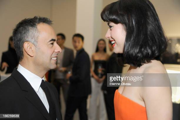 Women's Creative Director of Calvin Klein Francisco Costa and Singer Kimbra during the Calvin Klein special dinner at the Long March Space in 798 Art...