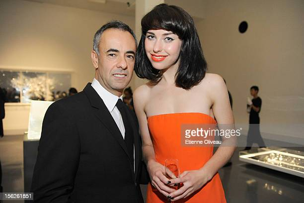 Women's Creative Director of Calvin Klein Francisco Costa and singer Kimbra pose for pictures during the Calvin Klein special dinner at the Long...