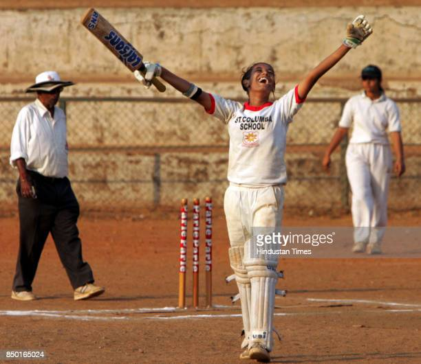 Women's Cricket Guri Sawant of St Columbia High school after hitting wining shot against IES Modern English School who scored 25 and also took 3...