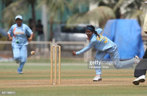 Womens Cricket Indian bowler Gauhar Sultana unsuccessfuly tries to hit the stumps to get England batswoman Shaw runout on the last ball of the first...