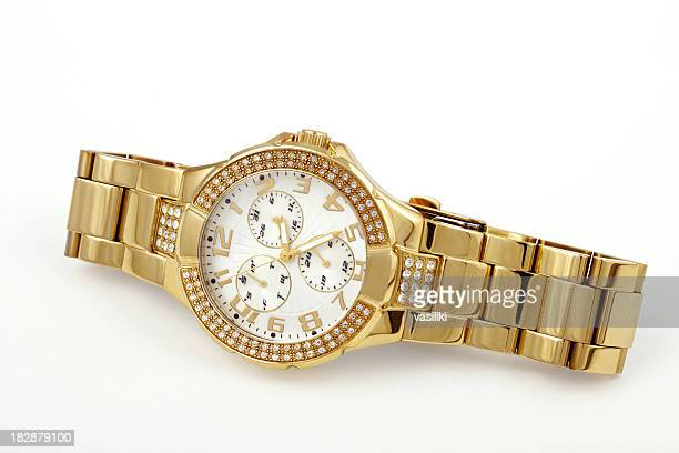 Women's crystal accented gold watch