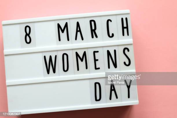 """women's day"" message in light box - international womens day stock pictures, royalty-free photos & images"