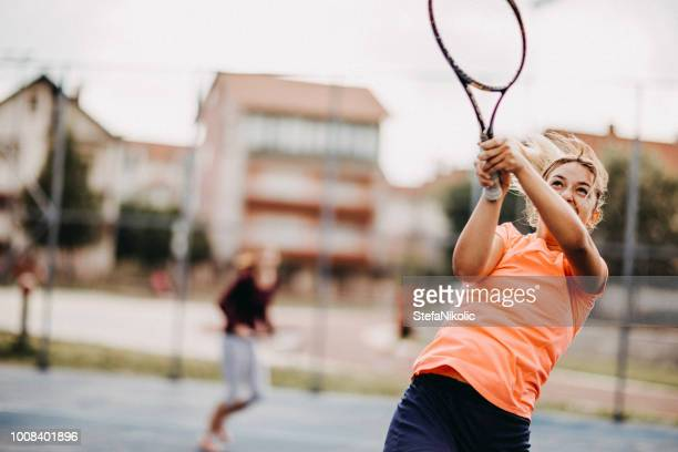 womens doubles match tennis volley - doubles sports competition format stock pictures, royalty-free photos & images