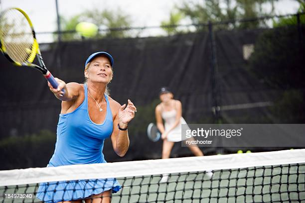 womens doubles match tennis volley - doubles stock photos and pictures