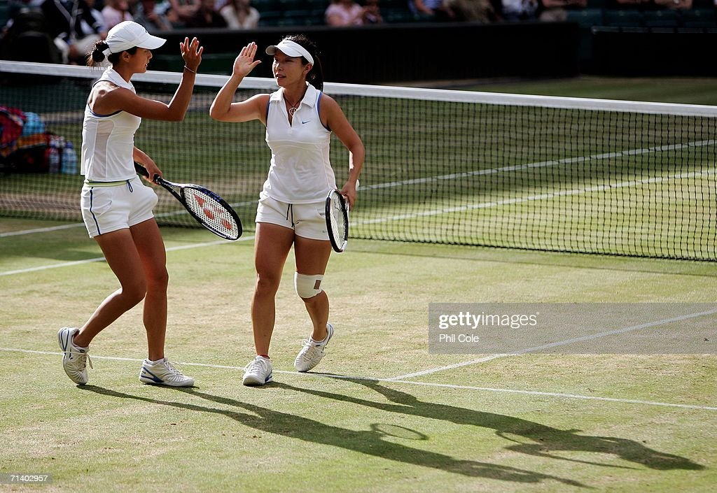 Women's doubles players, Zi Yan and Jie Zheng of China celebrate a point in their final match against Virginia Ruano Pascual of Spain and Paola Suarez of Argentina during day thirteen of the Wimbledon Lawn Tennis Championships at the All England Lawn Tennis and Croquet Club on July 9, 2006 in London, England.