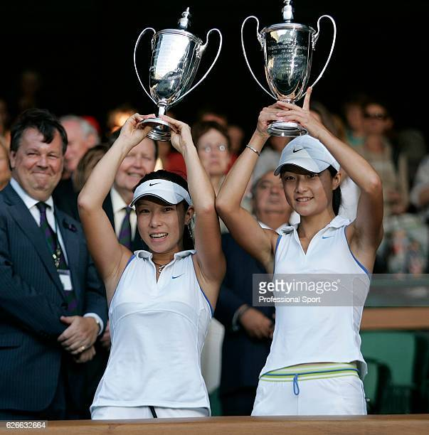 Women's doubles players, Zi Yan and Jie Zheng of China, hold their trophies after they won the final match over Virginia Ruano Pascual of Spain and...