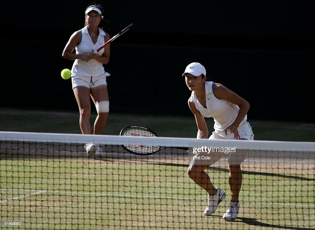 Women's doubles players, Zi Yan and Jie Zheng of China return a shot to Virginia Ruano Pascual of Spain and Paola Suarez of Argentina during day thirteen of the Wimbledon Lawn Tennis Championships at the All England Lawn Tennis and Croquet Club on July 9, 2006 in London, England.