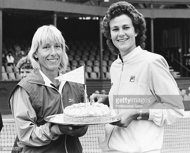 Women's Doubles tennis players Pam Shriver and Martina Navratilova hold a celebration cake after their 100th doubles win during the International...