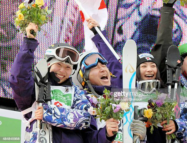 Women's Dual Mogul second Place Miki Ito Men's Dual Mogul second place Nobuyuki Nishi and Women's dual mogul first place Aiko Uemura celebrate on the...