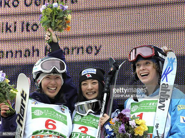 Women's dual mogul winner Aiko Uemura of Japan poses with second placed compatriot Miki Ito and 3rd placed Hannah Kearney of the US on the podium of...
