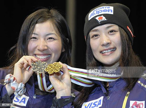 Women's dual mogul winner Aiko Uemura of Japan shows off her gold medal with second placed compatriot Miki Ito during the medal presentation ceremony...