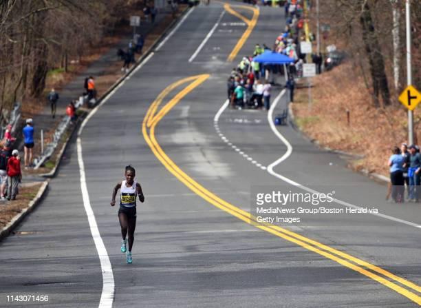 Women's elite leader Worknesh Degefa races far ahead of the field during the 123rd Boston Marathon on Monday April 15 2019 in Boston Massachusetts