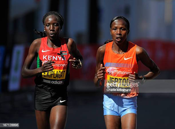 Women's Elite race winner Priscah Jeptoo and 2nd placed Edna Kiplagat of Kenya run through Canary Wharf during the Virgin London Marathon 2013 on...