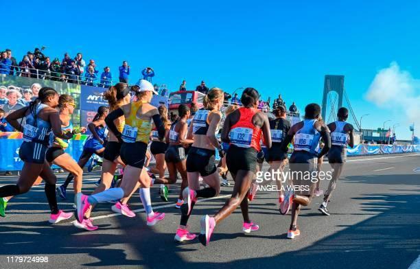Women's elite runners leave the start during the running of the 2019 TCS New York City Marathon November 3, 2019 in New York.