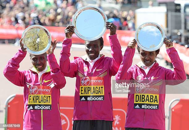 Women's Elite winner Edna Kiplagat of Kenya poses with second placed Florence Kipalgat of Kenya and third placed Tirunesh Dibaba of Ethiopia...