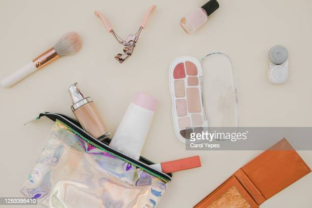 women's fashion. black handbag, makeup brushes on white background. flat composition. magazines, social media. top view. flat lay. - gold purse stock pictures, royalty-free photos & images