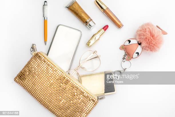 Women's fashion. black handbag, makeup brushes on white background. Flat composition. magazines, social media. Top view. Flat lay.