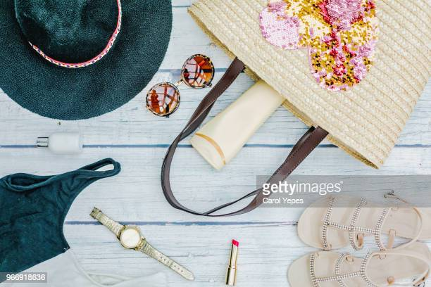 Women's fashion.  handbag, makeup brushes on blue background. magazines, social media. Top view. Flat lay.