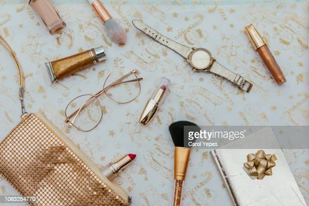 women's fashion.  handbag, makeup brushes on golden background. magazines, social media. top view. flat lay. - gold purse stock pictures, royalty-free photos & images