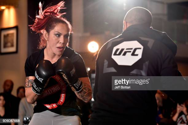 UFC women's featherweight champion Cris Cyborg of Brazil performs an open workout for fans and media during the UFC 222 Open Workouts at MGM Grand...