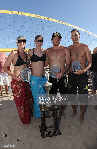 Women's final winners Heather Lowe and Tealle Hunkus and men's final winners Aaron Wachtfogal and Sean Rosenthal pose with the trophy after the final...