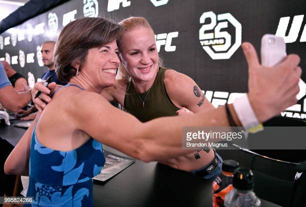 UFC women's flyweight fighter Valentina Shevchenko of Kyrgyzstan poses for a photo with a fan during the UFC Fan Experience at the Downtown Las Vegas...