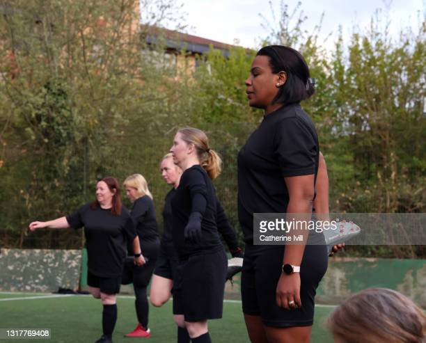 women's football team train for football game - menopossibilities stock pictures, royalty-free photos & images